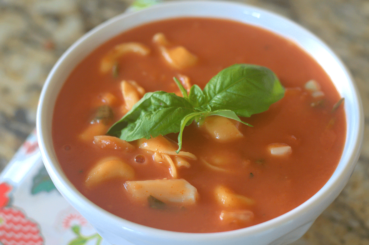 This yummy slow cooker creamy tomato basil tortellini soup is sure to be a hit with everyone in your family.